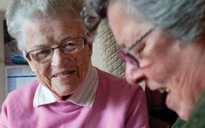 2 elderly women talking
